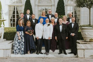 grooms-in-white-tuxedo-rosecliff-mansion-newport-rhode-island-staircase-portraits-outdoors
