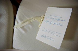 wedding-ceremony-program-with-blue-type-off-white-ribbon