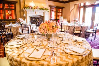 wedding-shower-table-with-a-floral-arrangement-of-pink-white-roses-in-golden-vase