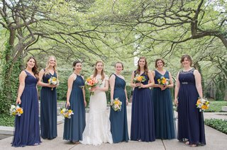 bride-in-romona-keveza-wedding-dress-and-bridesmaids-in-mismatched-blue-and-teal-wedding-dresses