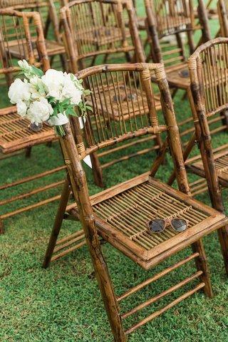wedding-ceremony-hawaii-montage-kapalua-bay-wood-rattan-bamboo-chair-sunglasses-white-flowers