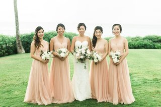 wedding-portrait-bride-with-bridesmaids-peach-apricot-bridesmaid-dresses-montage-kapalua-bay-lawn