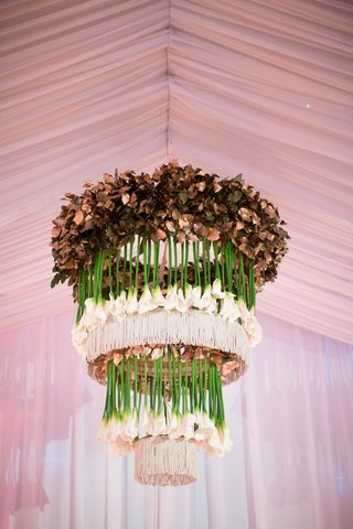 custom-tiered-floral-chandelier-made-of-gilded-leaves-fringe-and-upside-down-creamy-calla-lilies