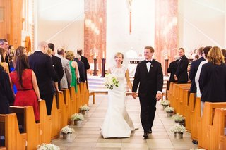 couple-walks-up-aisle-after-ceremony