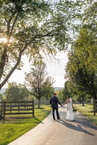 bride-in-alvina-valenta-wedding-dress-with-husband-on-farm