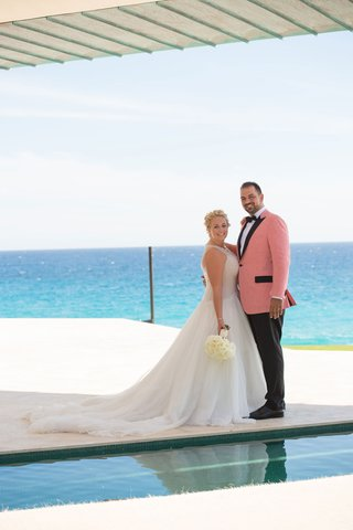 oceanside-wedding-portrait-bride-in-mark-zunino-groom-in-salmon-tuxedo-jacket