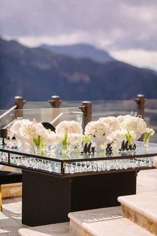 mirror-top-sweetheart-table-with-crystal-embellishments