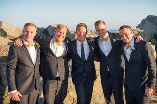 groom-groomsmen-different-ensembles-suits-gray-yellow-navy-white-on-beach-san-diego-wedding