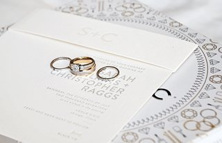 three-stone-engagemend-ring-with-smaller-side-stones-and-channel-set-band