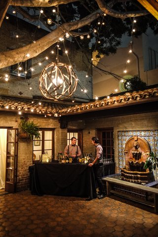 carondelet-house-courtyard-with-wooden-chandelier-and-lights-bar