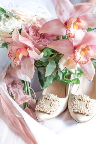 nude-wedding-shoes-vintage-inspired-pearl-buckle-on-toe-nude-ribbon-around-orchid-bouquet