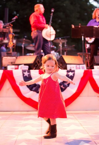 little-girl-in-red-dress-on-dance-floor-at-bbq