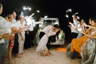 bride-in-lace-second-dress-for-grand-exit-beach-truck-sparkler-exit-on-beach-destination-wedding