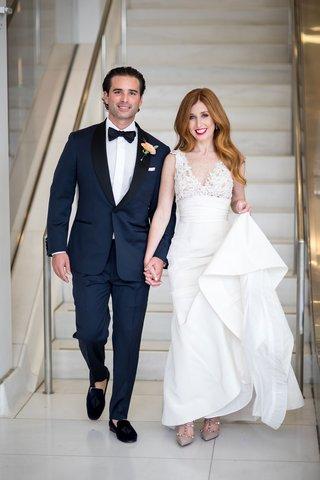 bride-in-v-neck-wedding-dress-mark-ingram-atelier-and-groom-in-navy-tuxedo-with-slipper-shoes