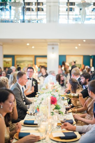 wedding-reception-at-santa-anita-race-track-long-table-with-gold-charger-plates-wine-champagne