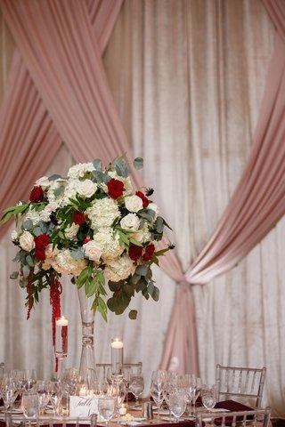wedding-reception-pink-drapes-ballroom-tall-centerpiece-white-hydrangea-red-rose-amaranthus-fall