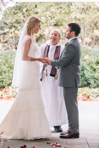 a-bride-and-groom-exchange-vows-in-alfresco-ceremony-space