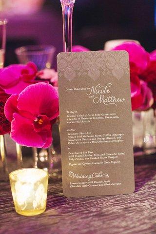 white-calligraphy-on-silver-and-grey-rectangular-menu-card-at-brooklyn-wedding-reception
