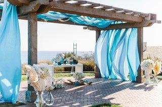 jewish-wedding-chuppah-with-ocean-view-terranea-blue-fabric-wood-pergola-arch