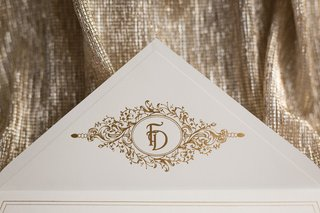 ivory-wedding-invitation-envelope-with-embellished-gold-monogram-on-inner-point