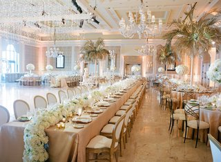 wedding-reception-the-breakers-chandeliers-palm-trees-gold-from-tables-long-table-flower-runner