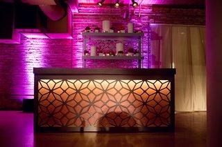 bar-with-geometric-design-illuminated-with-orange-lighting