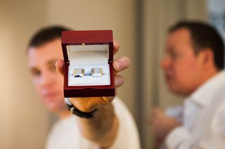 groom-holding-box-filled-with-custom-diamond-cuff-links