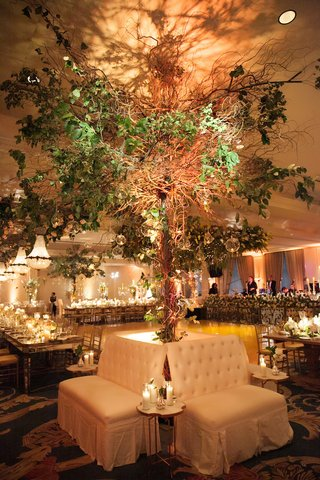 tall-tree-flower-arrangement-behind-lounge-furniture-rentals