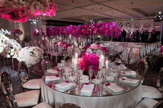wedding-reception-mirror-table-top-velvet-chairs-fuchsia-and-hot-pink-orchids-and-flowers-candles
