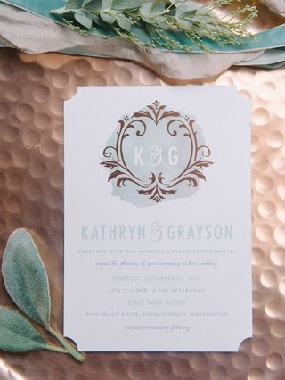 blue-and-white-watercolor-invitations-on-a-rose-gold-backdrop-with-leaves