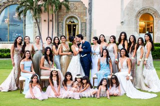bride-and-groom-with-wedding-party-bridesmaids-in-mismatched-dresses-flower-girls-in-pink-mar-a-lago