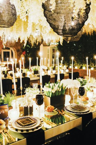 destination-wedding-decor-mykonos-greece-black-glassware-goblets-tulips-gold-table-mirror-top