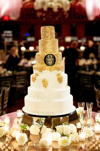 seven-tier-cake-with-gold-glitter-and-monogram-on-black
