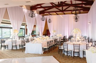 all-white-color-scheme-white-bouquets-chandeliers-bel-air-bay-club-wedding-reception