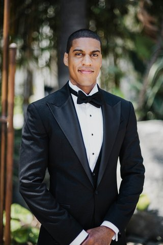 groom-in-custom-tuxedo-and-textured-jacket-bow-tie
