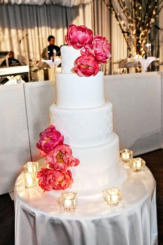 white-wedding-cake-decorated-with-fresh-pink-peonies