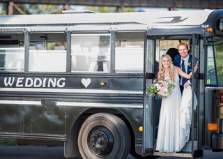 bride-and-groom-on-school-bus-painted-black-and-personalized-with-their-names-and-a-heart-transport