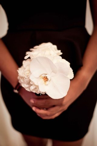 african-american-woman-holding-white-bouquet