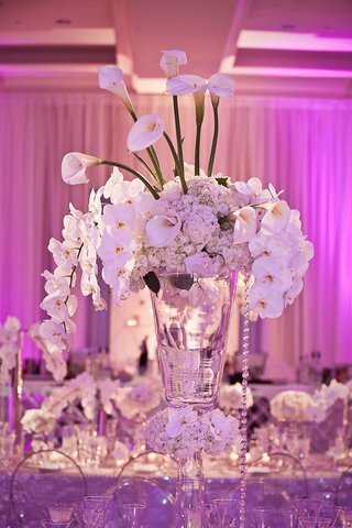 purple-pink-lighting-and-white-floral-arrangement