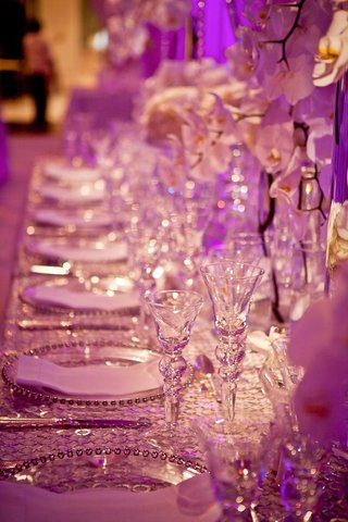 violet-lighting-illuminating-crystal-glassware-and-table