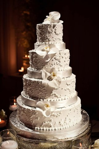 four-layer-white-cake-with-orchids-and-ribbons