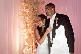 basketball-player-joshua-smith-and-bride-next-to-cake