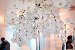 white-orchids-on-crystal-candelabrum
