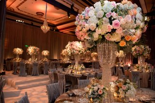 wedding-reception-opulent-centerpiece-with-pink-orange-white-rose-flowers-white-hydrangea-crystals