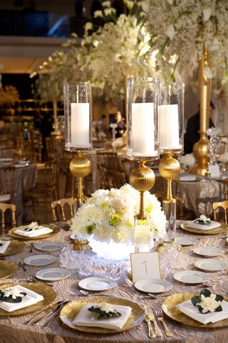 wedding-reception-table-with-illuminated-rock-crystal-bowl-filled-with-white-peonies