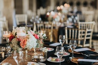 wedding-reception-black-linens-gold-details-floating-candles-white-hydrangeas-peach-garden-roses