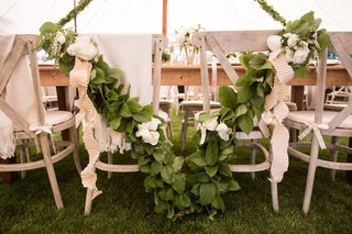 newlyweds-chair-decorations-with-garland-and-ribbon