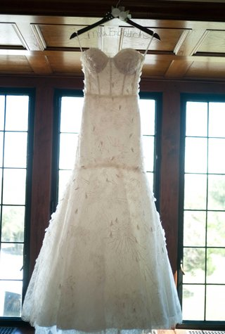 brides-monique-lhuillier-wedding-dress-on-display-while-she-gets-ready-before-ceremony