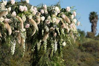 echosmith-singer-sydney-sierota-and-cameron-quiseng-wedding-ceremony-structure-flower-arch-greenery