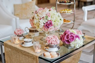 french-macaron-and-tea-sized-desserts-on-glass-table